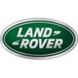 Oval logo with the lettering Land Rover in all Capitals done in silver with a green background.